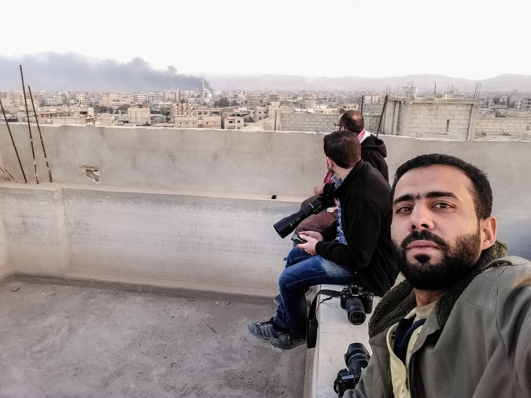 Salem Mdlala and fellow photographers in Ghouta.
